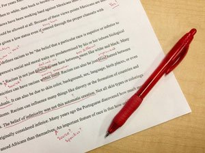 Picture of red ink revisions during the writing process.